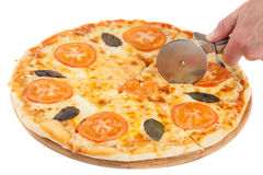 Pizza cutting isolated on white Stock Photos