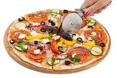 Pizza cutting isolated on white Stock Images