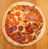 Pizza de cuatro estaciones Foto de archivo libre de regalías