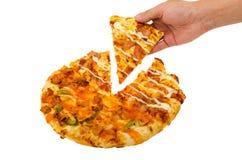 pizza del control de la mano del hombre Fotos de archivo