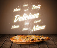 Pizza with delicious and tasty glowing writings Royalty Free Stock Photography