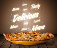 Pizza with delicious and tasty glowing writings Royalty Free Stock Photo