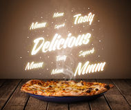 Pizza with delicious and tasty glowing writings Stock Photography