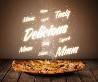 Pizza with delicious and tasty glowing writings Stock Photo