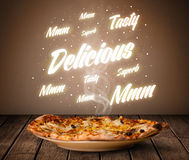 Pizza with delicious and tasty glowing writings Stock Images