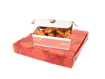 Pizza delivery box and chicken wings Royalty Free Stock Image