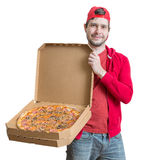Pizza delivery concept. Young man is holding boxes with pizza. Royalty Free Stock Image