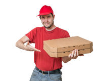 Pizza delivery concept. Young smiling boy holds boxes with pizza. Stock Image