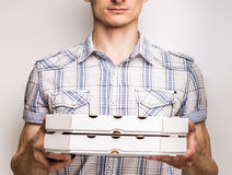 Pizza delivery courier in shirt Royalty Free Stock Photography