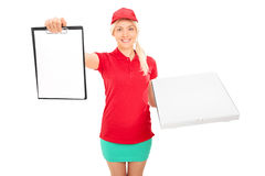 Pizza delivery girl holding a clipboard Royalty Free Stock Photo