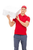 Pizza delivery guy carrying boxes over his shoulder Stock Images
