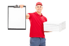 Pizza delivery guy holding a clipboard Stock Photography