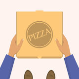 Pizza delivery. Handing product boxes. Delivery men handing a box with pizza Royalty Free Stock Image