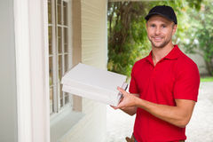 Pizza delivery man delivering pizzas Stock Image