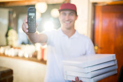 Pizza delivery man holding phone Stock Image