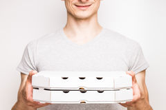 Pizza delivery man holds two boxes. Stock Image