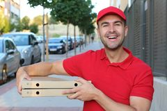 Pizza delivery man looking at camera royalty free stock photos