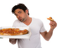 Pizza delivery man with a pizza Stock Photography