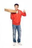 Pizza delivery man showing thumbs up Royalty Free Stock Image