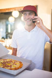 Pizza delivery man taking an order over the phone Royalty Free Stock Photos