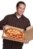 Pizza della holding dell'uomo Immagine Stock