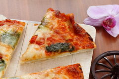 Pizza on desk Royalty Free Stock Images