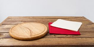 Pizza desk, white and red napkin on table, tablecloth, copy space, empty.  stock images
