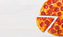 Pizza Diabolo slice, top view. Pizza Diabolo slice on white background, top view, recipe mockup, copy space stock photos