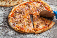 Pizza with different toppings. Italian pizza with different sorts of cheese, vegetables and meat on old wooden background close up. Italian traditional food Royalty Free Stock Photo