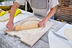 Pizza dough. Chef rolling out pizza dough Royalty Free Stock Photo