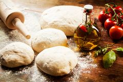Pizza Dough. Fresh pizza dough, chili oil, herbs and tomatoes Stock Images