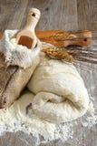 Pizza dough and bread Stock Image