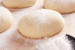 Pizza dough. On floured cutting board Stock Image