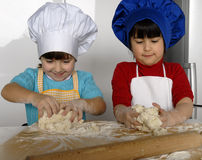 Pizza dough girls. Royalty Free Stock Photography