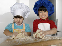 Pizza dough girls. Royalty Free Stock Photos