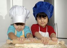 Pizza dough girls. Stock Photography