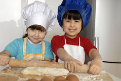 Pizza dough girls. Royalty Free Stock Image