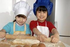 Pizza dough girls. Royalty Free Stock Image