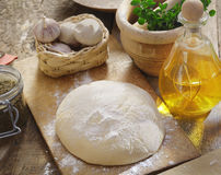 Pizza dough and ingredients Royalty Free Stock Photography