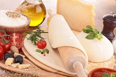 Pizza dough and ingredients Royalty Free Stock Image