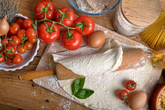 Pizza dough and ingredients Stock Image