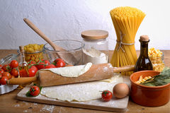 Pizza dough and ingredients Royalty Free Stock Photos