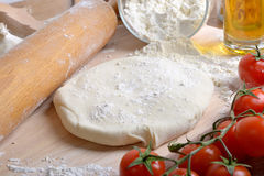 Pizza dough and ingredients. With tomatoes and olive oil Royalty Free Stock Image