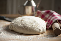 Pizza dough. Rising on wooden cutting board Royalty Free Stock Images