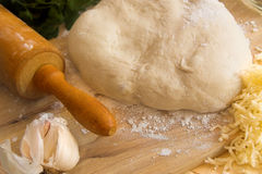Pizza dough and rolling pin Stock Photography