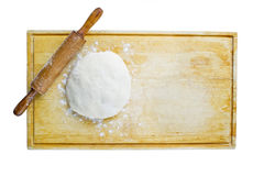 Pizza dough and rolling pin. On wooden worktop Stock Image