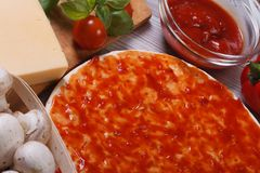 Pizza dough smeared tomato sauce Stock Images