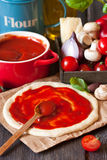 Pizza dough. Pizza dough with tomato sauce and ingredients Stock Image
