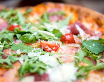 Pizza with dry cured ham and arugula Royalty Free Stock Photography