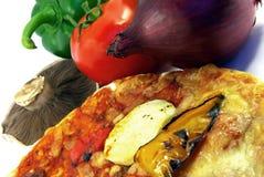 Pizza e close-up dos ingredientes Fotografia de Stock